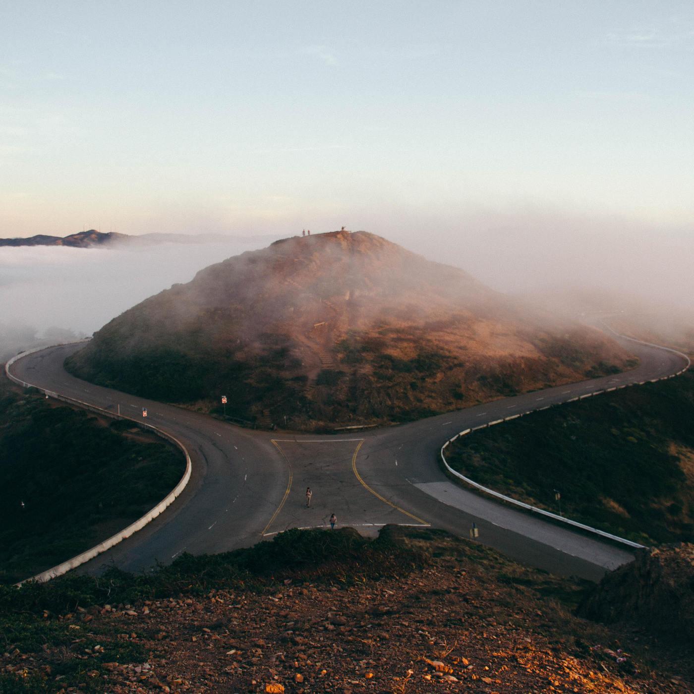 roads merging, outside mountain