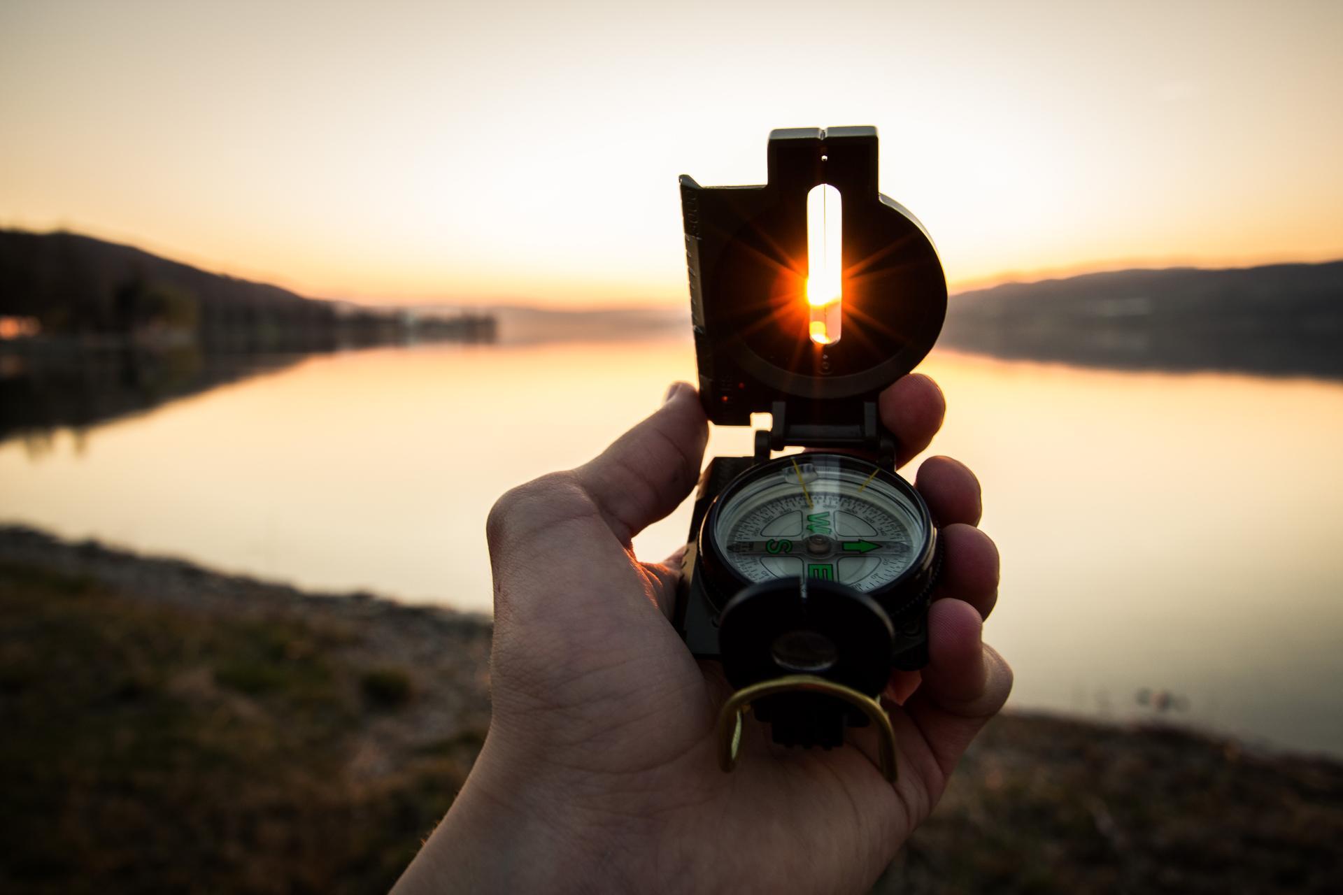 navigate-compass-lake-tim-graf-ErO0E8wZaTA-unsplash