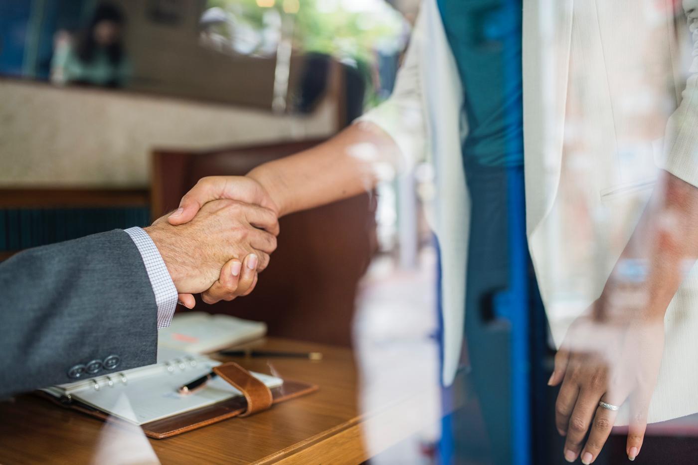 business folks shaking hands